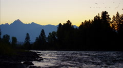 Sunset view of Kootenay Mountain Range Canada BC Stock Footage