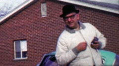 1958: Funny guy pranking camera man staring at hidden camera lens. Stock Footage