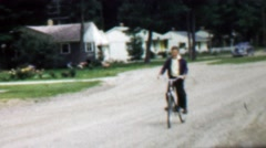 1957: Boy riding bike confidentially coming home from play date. Stock Footage