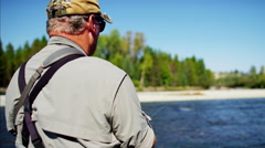 Skilled hobby fisherman casting line freshwater fishing Canada - stock footage