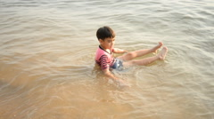Little boy swimming on the beach Stock Footage