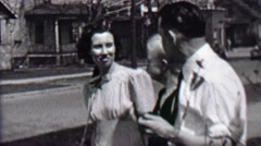 1939: Family together front yard windy day neighborhood city home. Stock Footage
