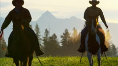 Silhouette of Cowboy Riders running in the wilderness Canada Stock Footage