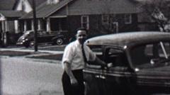 1939: White collared working man smoking pipe car owner suburban pride. Stock Footage