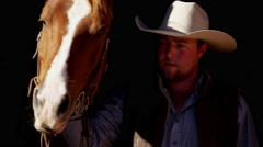 Cowboy Ranch hand with horse on Dude Ranch in Corral Canada Stock Footage