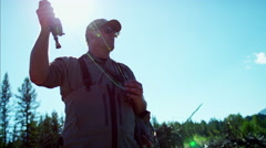 Skilled hobby fisherman in silhouette casting line freshwater fishing Canada - stock footage