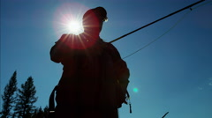Silhouette of skilled hobby freshwater fisherman casting fishing line Canada Stock Footage