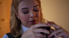 Lonely businesswoman sitting in office, drinking wine and thinking about life Stock Footage