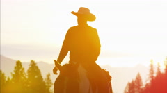 Silhouette of Cowboy Riders forest wilderness area Canada Arkistovideo