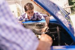 Old Man Grandpa Teaching Boy Fixing Car Engine Stock Photos