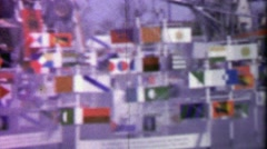 1964: Spinning wind powered flag display EXPO New York World's Fair. Stock Footage
