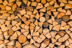 background - woodlogs cleaved for the stove close-up - stock photo