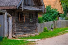 Dilapidated wooden house in the village Stock Photos