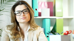 Uninterested businesswoman talking with someone, steadycam shot - stock footage