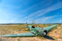 The remains of the crashed military aircraft in the field Stock Photos