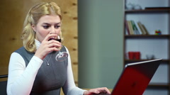 Blond woman typing fast, angrily responding to email, feeling irritated at work Stock Footage