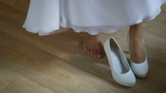 Bride dressing shoes Stock Footage
