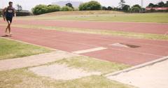 Sportsman doing long jump Stock Footage