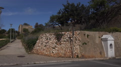 4k Historic city town wall tourists with bagage Lagos Portugal Stock Footage