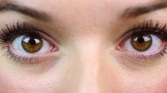 Macro view of surprised female eyes, beautiful girl saw something frightening Stock Footage