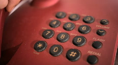 Dialing red keypad phone - stock footage