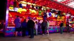 People playing carnival game with miniature effect Stock Footage