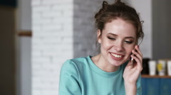 Woman talking on the phone, laugh in the cafe. - stock footage