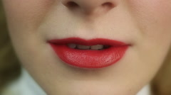 Stock Video Footage of Seductive beautiful female flirting and biting lip. Perfect make-up. Red lips
