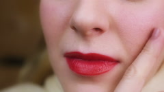 Woman seductively touching her face, flirting with someone. Sensual red lips Stock Footage