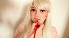 Makeup, applyinglip pencil Stock Footage