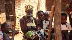 Africa native village family eating in kitchen Stock Footage
