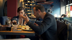 Young couple fighting, arguing during meal in cafe  Stock Footage