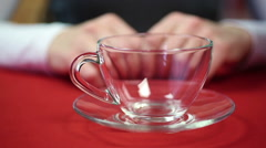 Woman is going to drink tea. Female pouring hot water into the cup. Break time Stock Footage