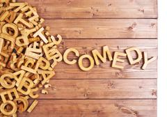 Word comedy made with wooden letters - stock photo