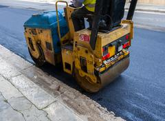 Light vibration roller compactor at asphalt pavement works for road repairing Stock Photos