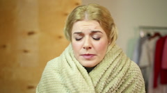 Sneezing blond woman at home. Medicine and healthcare, allergies and cold Stock Footage