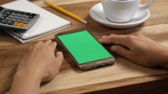Close-up of female hands using a smart phone. chroma-key, green-screen - stock footage