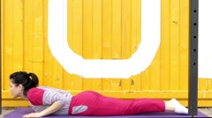 Girl in Costume Making Snake Pose From the Yoga. - stock footage
