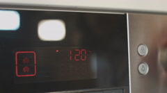 Turning on a kitchen oven - stock footage
