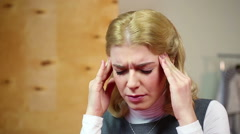 Blond woman having headache, nervous breakdown at work.  Stress and problems Stock Footage