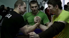 Men practicing arm wrestling in the gym Stock Footage