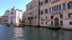 Gondolas cruise along the Grand Canal, Venice Stock Footage