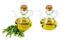 Olive oil glass vessel isolated - stock photo