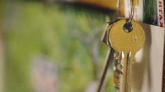 Man hangs up the keys on the hook. Stock Footage
