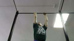 Man doing exercises on the horizontal bar in the gym Stock Footage