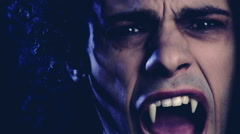 Portrait of angry vampire looking camera at night Stock Footage