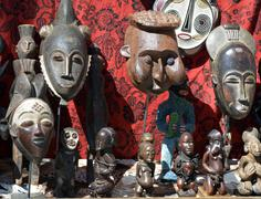African masks and statues in a flea market stall Stock Photos