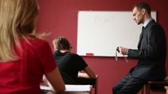 Male teacher giving a lecture at the university Arkistovideo