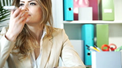 Stock Video Footage of Businesswoman talking on loudspeaker in the office, steadycam shot