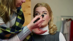 Professional artist applying makeup on set. Actress getting ready for filming Stock Footage